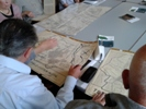 Malcolm studying a post enclosure map, 1774