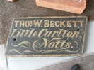 Sign from farm cart depicting owner's name