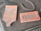 Shaped roof tile and stamped brick