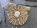First stage of making a basketry base, completed base underneath