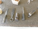 Selection of basketry tools including, left to right; knife, beater, shave, bodkin and another shave