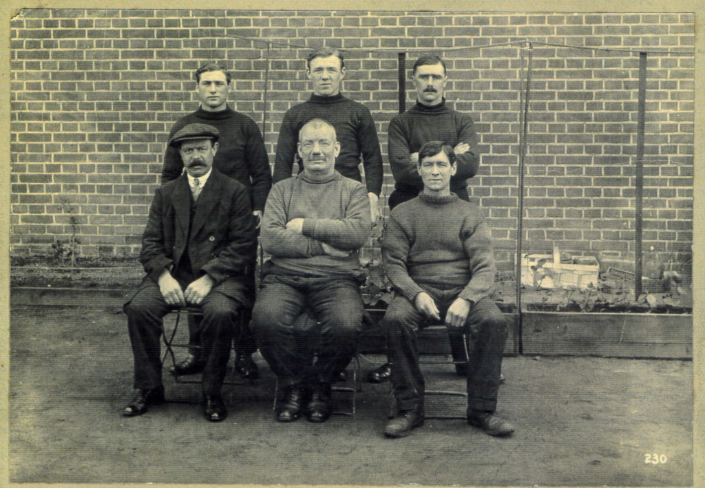 John Green, centre, seated.